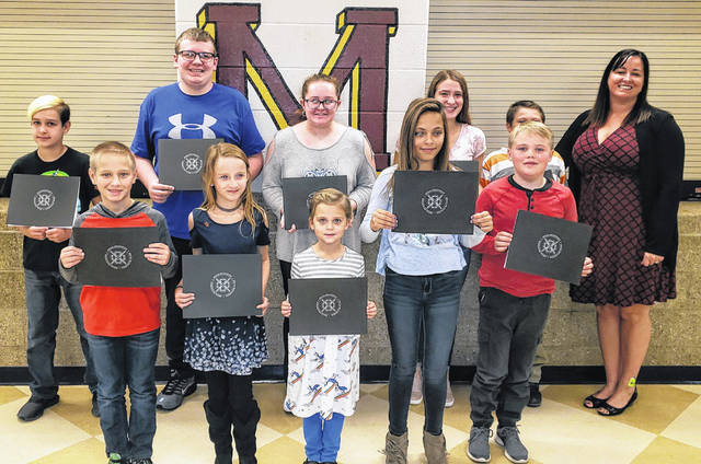 Meigs Local students of the month in attendance at the meeting are pictured with board member Heather Hawley.