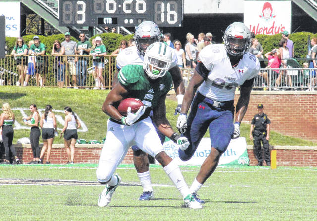 Ohio sophomore Cameron Odom breaks away from a pair of Howard defenders, during the Bobcats' win on Sept. 1 in Athens, Ohio.