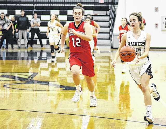 RVHS junior Savannah Reese (15) dribbles the ball on a breakaway during the second half of the Lady Raiders 36-24 victory over Jackson on Thursday night in Bidwell, Ohio.