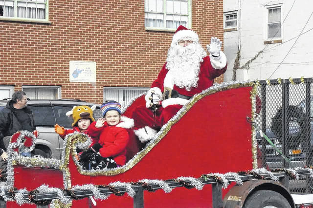 Santa waving to parade goers during last year's Christmas parade in Mason.