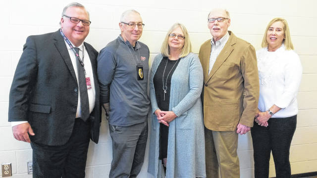 The University of Rio Grande and Rio Grande Community College awarded Carolyn Berry as the campus police department's, honorary, officer of the year. Pictured (left to right) are Chief Financial Officer Tim Pruett, Campus Police Chief Scott Borden, Officer of the Year Carolyn Berry, Board of Trustees member Larry Rees and Laura Rees.