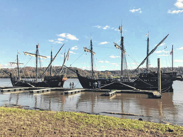 The Nina and the Pinta sit docked in front of Gallipolis waterfront area with visitors lining up to see the historic ship replicas before they set sail again after Wednesday viewing times ending at 5 p.m.