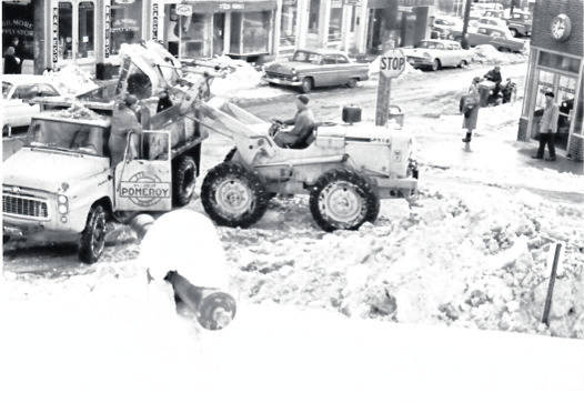 Meigs County has seen its first snowfall for the year and more wintry weather is yet to come. As part of Throwback Thursday, pictured is an undated, snowy scene from years past of Second Street and Mulberry Avenue, with workers trying to clear away the snow from the roadway.