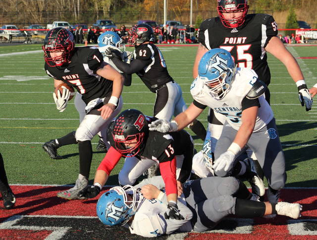 Point Pleasant senior Cason Payne (7) follows a block by James Musgrave (13) into the end zone for a touchdown during the third quarter of Saturday's Class AA opening round playoff game against Mingo Central at OVB Field in Point Pleasant, W.Va.