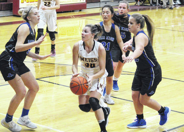 Meigs senior Kassidy Betzing (center) drives through the Gallia Academy defense, during the Lady Marauders' 60-25 victory on Saturday in Rocksprings, Ohio.