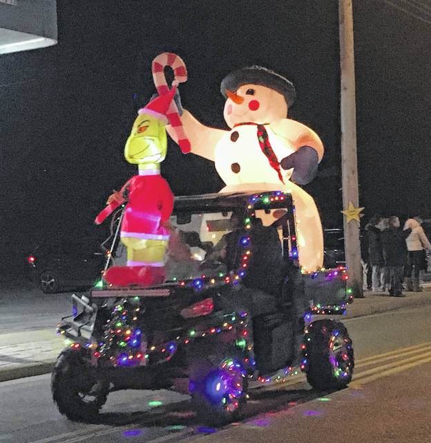 The Grinch and a Snowman rode in the the parade on Saturday evening in Racine.
