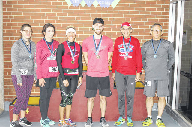 River City Runners Race Series winners included (from left) Cheryl O'Bryant (3rd), Gina Tillis (2nd), Gabby Sanders (1st), Cody Ridgway (1st), William Condee (2nd) and Don Tillis (3rd).