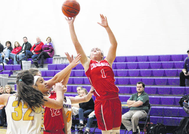 Wahama junior Hannah Rose (1) tries a two-pointer, during the Lady Falcons' 64-28 win on Monday in Racine, Ohio.