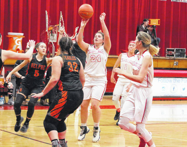 Wahama sophomore Harley Roush (24) releases a shot attempt during the first half of Thursday night's TVC Hocking girls basketball game against Belpre at Gary Clark Court in Mason, W.Va.
