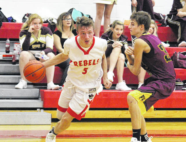 South Gallia junior Jared Burdette (5) drives past a Federal Hocking defender, during the Rebels' 58-48 victory on Friday in Mercerville, Ohio.
