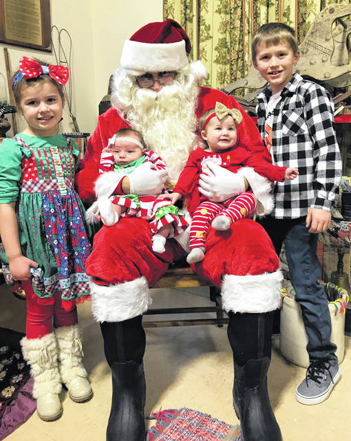 (From left) Addison Hysell, Macie Crites, Harper Hysell, and Gavin Hysell visited with Santa on Saturday at the Meigs Museum.