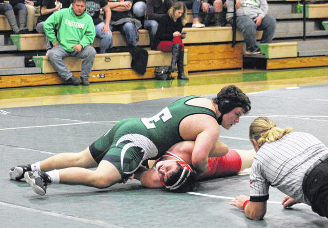 Eastern junior Ethan Kline scores a pinfall victory over Wahama's heavyweight, during the 'Battle of the Birds' on Wednesday in Tuppers Plains, Ohio.