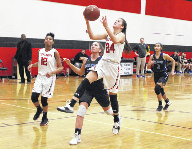 Point Pleasant freshman Brooke Warner (24) releases a shot attempt during a Nov. 29 girls basketball contest against Gallia Academy in Point Pleasant, W.Va.