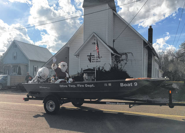 Santa arrived in the Olive Twp. Fire Department Rescue Boat as part of the parade on Sunday in Reedsville.