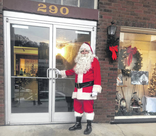 Santa is pictured entering the Riverbend Arts Council building before greeting the children on Saturday.