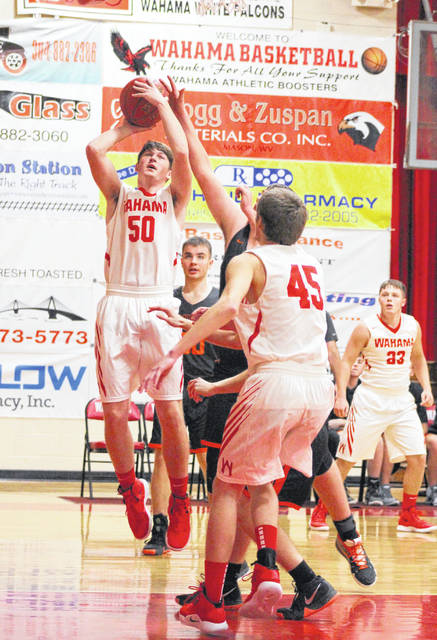 Wahama senior Jacob Warth (50) is fouled during a shot attempt in the first quarter of Tuesday night's season-opening boys basketball contest against Wirt County at Gary Clark Court in Mason, W.Va.