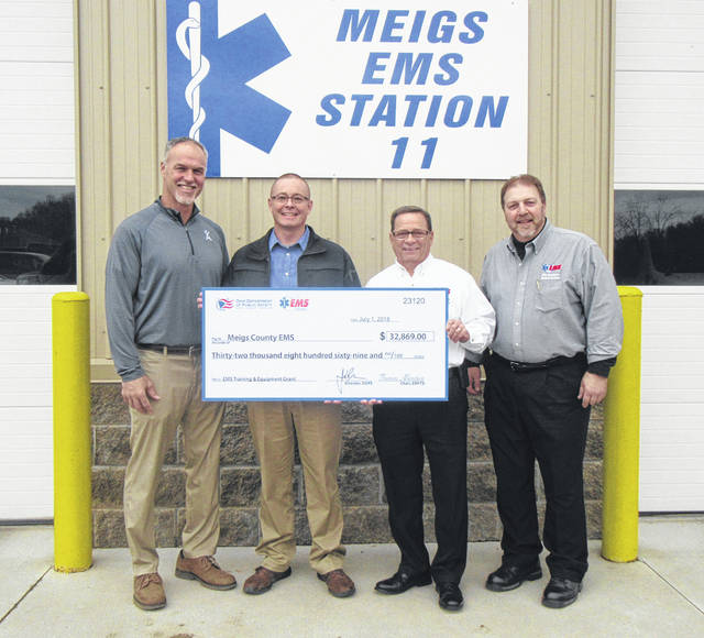 Meigs County EMS recently received grant funds from Ohio EMS. Pictured are Commissioner Mike Bartrum, Meigs EMS Director Robbie Jacks, Ohio EMS Director Mel House and Ohio EMS Deputy Director Rob Wagoner.