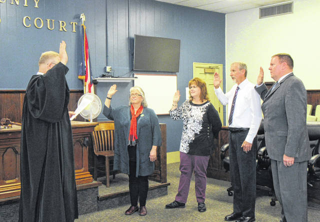 A ceremony was held on Thursday morning for the newly elected Meigs County officials who will begin their terms in 2019. Judge Scott Powell issued the oath of office to Commissioner Tim Ihle, as well as symbolic oaths to Common Pleas Judge-elect Linda Warner, County Court Judge Mick Barr (recently appointed to fill the remainder of Judge Steve Story's term), and Auditor Mary T. Byer-Hill. An official swearing-in will take place Dec. 28 for Judge Warner and Judge Barr, while Auditor Byer-Hill will be sworn-in closer to the beginning of her term in March. For Warner, Barr and Byer-Hill, Thursday was symbolic, as an opportunity to celebrate with co-workers and other elected officials. All four were elected during the November 2018 General Election.