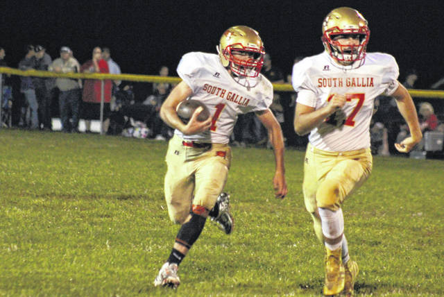 South Gallia's Kyle Northup (1) carries the ball behind a block from Gavin Bevan (17), during the Rebels' loss to Southern on Sept. 28 in Racine, Ohio.
