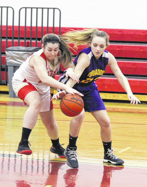 South Gallia junior Christine Griffith, left, and Southern junior Shelby Cleland battle for a loose ball during the second half of Thursday night's TVC Hocking girls basketball contest in Mercerville, Ohio.