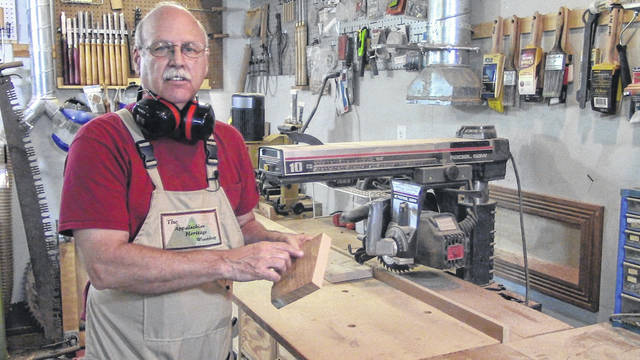 Jerill Vance working on a project in his wood shop.