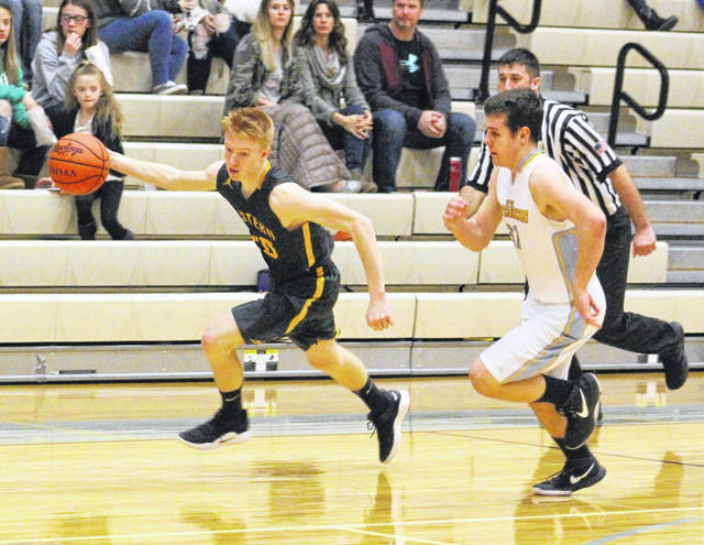 Eastern junior Ryan Dill, left, breaks away from Ohio Valley Christian senior Miciah Swab following a turnover in the second half of Tuesday night's boys basketball contest in Gallipolis, Ohio.
