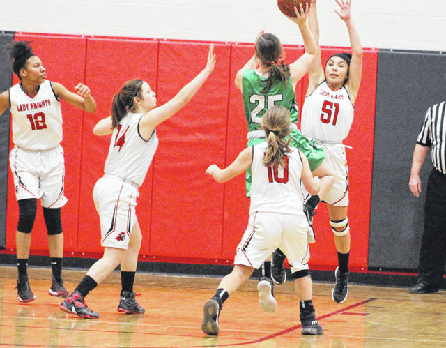 Point Pleasant sophomore Naomi Meisser (51) contests a shot attempt by a Winfield player during the second half of Thursday night's girls basketball contest in Point Pleasant, W.Va.