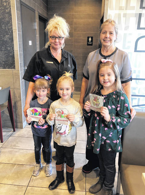 The winners of The Daily Sentinel's annual Christmas Coloring Contest received their prizes on Friday. Pictured are (front, from left) first place, Isabella Rose Baughman of Rutland; second place, Averi Hill of Ravenswood, W.Va.; third place, Layla Nibert of Syracuse. Also pictured are McDonald's employees Kim Bias and Connie Roush. The coloring page is sponsored by Home National Bank, with the prizes sponsored by McDonald's of Pomeroy.