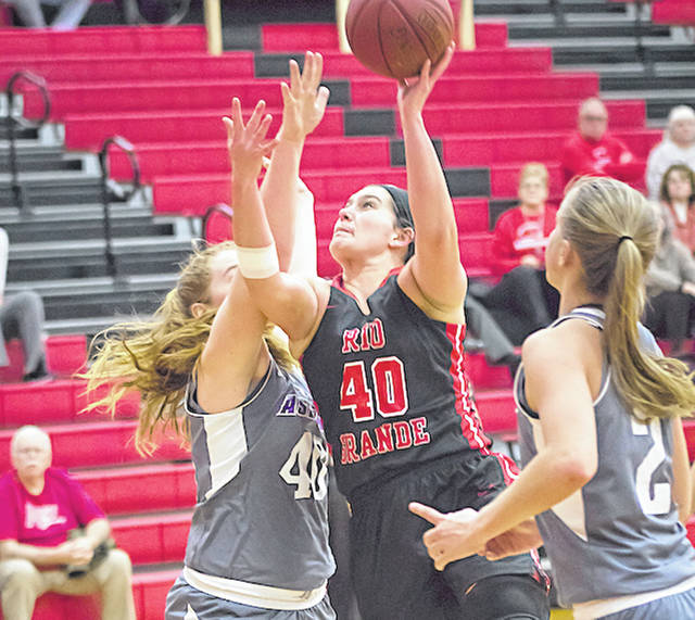 Rio Grande's Natalie Seeberg works through the Asbury defense to get off a shot in the second half of Tuesday night's game against the Eagles at the Newt Oliver Arena. The RedStorm suffered an 86-69 loss.