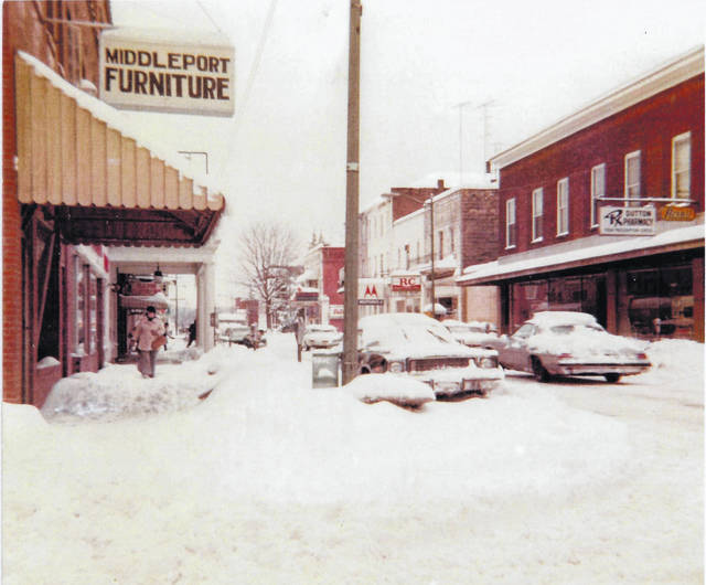 January 1978 brought snow to the region as seen in this photo of a snowy Second Avenue in the village of Middleport. The photo dated Jan. 20, 1978, shows snow on the roadway and cars, as well as piles where the snow had been cleared from the entrances to businesses. One man is even carrying a snow shovel as he walks along the sidewalk.
