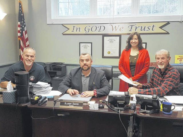The Commissioners are pictured with Debbie Mohler after approving a resolution for Sanctity of Life Day. Pictured from left are Mike Bartrum, Randy Smith, Mohler and Time Ihle.