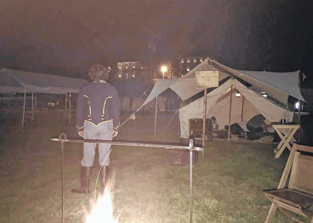 """""""As the 7th OVC camps in front of the Chester courthouse, one has to think of 155 years ago another 16 year old soldier looked up at the Chester Courthouse and wondered if or when he would see home again,"""" reads the photo caption on the 7th Ohio Volunteer Cavalry Facebook page about this image."""