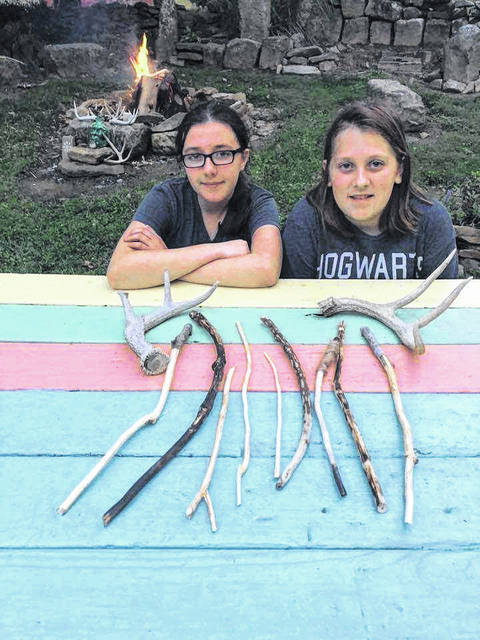 Lily Colley (left) and Silas Easter (right) kickstarted a new venture after trying their hand at whittling wands.