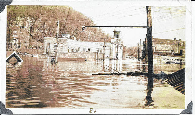 "This weekend in 1937 brought record high water along the Ohio River, including the second highest crest on record in Pomeroy at 67.80 feet on January 28, 1937. The 1937 flood crested just one foot shy of the 1913 flood, according to records from the National Weather Service. This photo from John P. Scott looks north onto Second Street from intersection of Butternut during the historic flooding. Scott's photos from around Pomeroy during the flood can be found on the Meigs County Historical Society Facebook page and include ""Then and Now"" photos which were taken by Jennifer Harrison and Mary Wise in 2012 to mark the 75th anniversary of the flood."