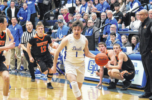 Gallia Academy senior Cole Davis (1) drives in for a layup after picking off a pass, during the Blue Devils' double-overtime setback on Friday in Centenary, Ohio.