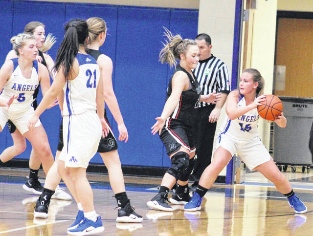 Gallia Academy sophomore Koren Truance (15) looks to make a pass into the low block during the second half of Thursday night's girls basketball game against Coal Grove in Centenary, Ohio.