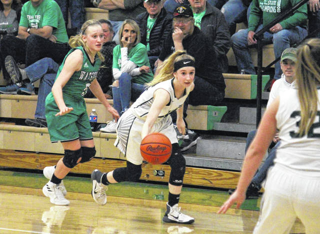 EHS sophomore Kennadi Rockhold (center) brings the ball up court past the Waterford press, during Eastern's 53-44 setback on Monday in Tuppers Plains, Ohio.