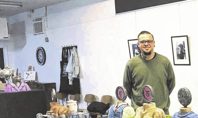 "Gabe Richmond's art show ""In A New Light"" will be at the Artisan Shoppe & Studio through the first part of February. Pictured is Richmond with some of his art pieces."