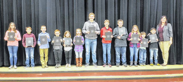 "The Meigs Local School Board recently honored its ""Students of the Month."" Recognized for the honor are Maddie Ennos, Zach Bartrum, Austin Mahr, Alexandria Ogdin, Jessica Workman, Charlotte Hysell, Caleb Ogdin, Mya Smith, Dakota Erwin, Tessa Bentz, Cayden Gheen, Jacob Roush, Dakota Writesel, Jaydin Meyers, Griffin Hudson, Gracie Hill, Josh Wilson, Maria Riddle, Opal Stover, Connor Thomas, Maddison Johnson, Cain Dugan, Cashel Whitlatch. Some of those students are pictured here with School Board Member Heather Hawley."