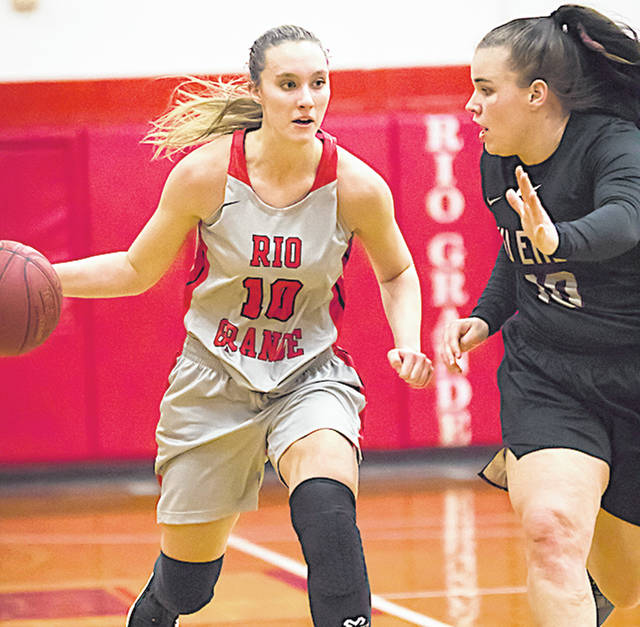 Rio Grande's Chelsy Slone drives past Indiana East's Bailey Dreiman during Tuesday night's game at the Newt Oliver Arena. Slone finished with 17 points, but the RedStorm suffered an 84-78 loss to the Red Wolves.