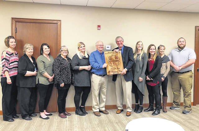Carson Crow is pictured with the Common Pleas Court staff at his recent retirement party. Crow was presented with a plaque with the state seal, as well as information about his time as judge.