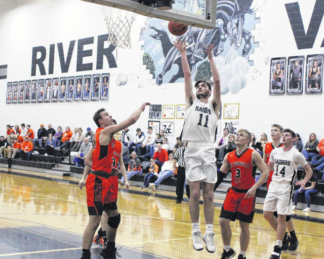 River Valley junior Brandon Call (11) releases a shot attempt during the first half of Friday night's TVC Ohio boys basketball contest against Nelsonville-York in Bidwell, Ohio.