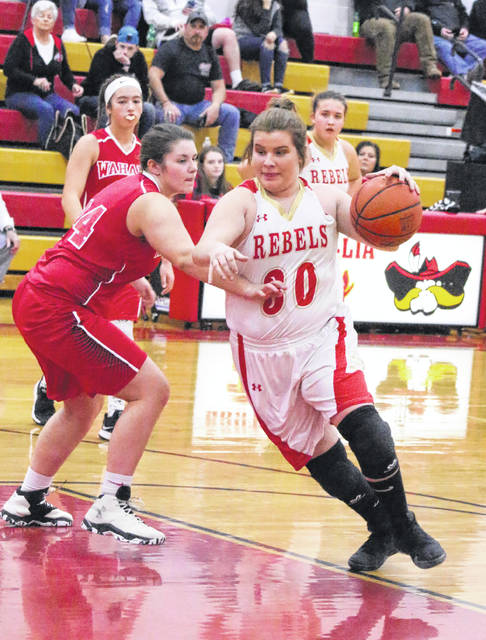 South Gallia sophomore Faith Poling (30) dribbles past Wahama defender Harley Roush during the first half of Thursday night's TVC Hocking girls basketball contest in Mercerville, Ohio.