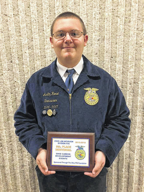 Austin Rose is pictured with his plaque for 9th place in State Job Interview for his division.