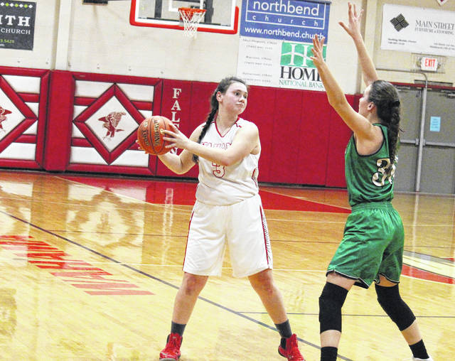 Wahama sophomore Torre VanMatre (3) looks to pass around a Waterford defender, during the Lady Wildcats' 53-33 victory on Monday in Mason, W.Va.