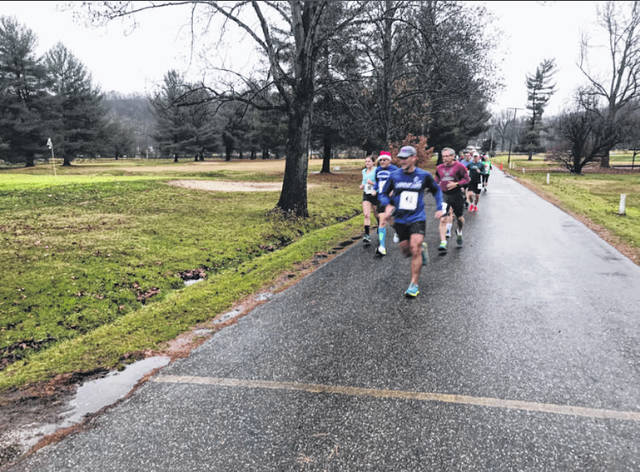 "The River City Runners group hosts a variety of races and activities to raise money for the American Cancer Society, including the upcoming production of ""Love Letters."" Pictured are runners in the Jingle All the Way 5K held last last year."