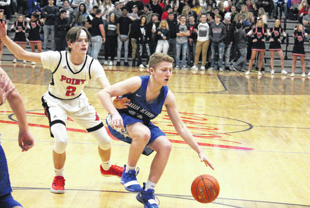 Gallia Academy's Justin Wilcoxon (right) drives past Point Pleasant's Kyelar Morrow (2), during the Blue Devils' 65-28 victory on Saturday in Point Pleasant, W.Va.