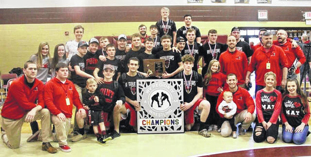 Members of the Point Pleasant wrestling team pose for a picture after winning the 2019 Class AA-A Region IV championship on Saturday at Williamstown High School in Williamstown, W.Va.