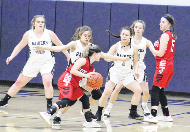 River Valley defenders Kelsey Brown (32), Lauren Twyman, Cierra Roberts (1) and Savannah Reese apply pressure to Jackson's Katelyn Webb during the first half of Monday night's Division II sectional semifinal basketball contest at Wellston High School in Wellston, Ohio.