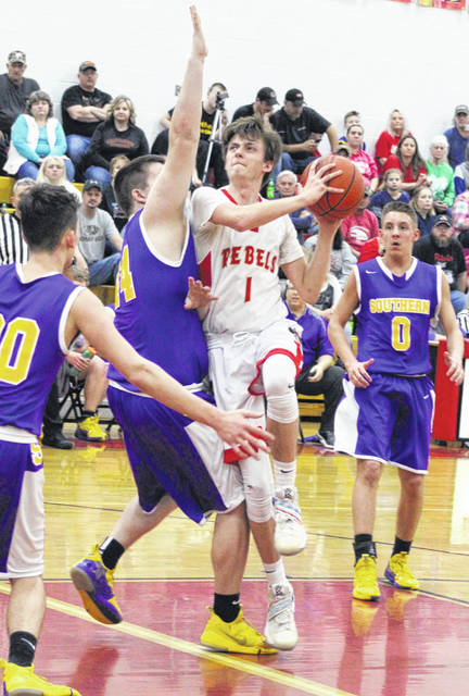 South Gallia senior Braxton Hardy (1) drives to the basket during the first half of a Feb.5 boys basketball contest against Southern in Mercerville, Ohio.